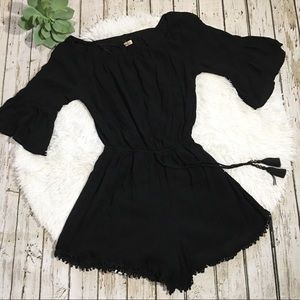 Hollister black romper fringe ball trim small